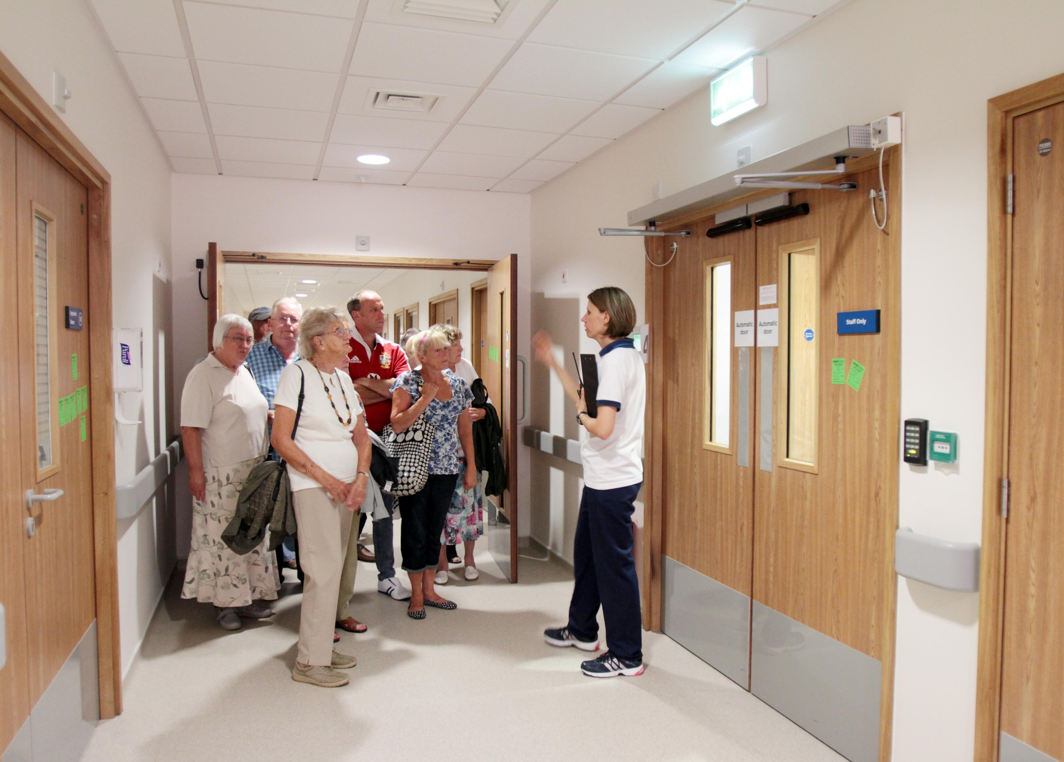 Occupational therapist Clarie Plummer takes a group of visitors round the new hospital copy