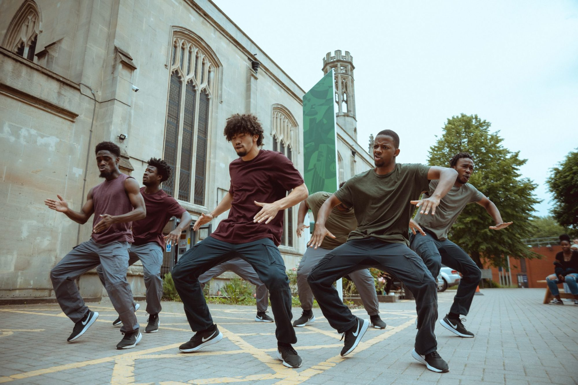 a group dances outside the Trinity Building in Bristol, as part of Born to Protest - a hip-hop dance theatre show by choreographer Joseph Toonga